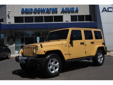 Pre-Owned 2014 Jeep Wrangler Unlimited Sahara w/Nav